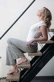 Woman on the stairs Stock Images