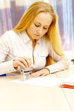 Woman stamps her paper. Royalty Free Stock Photography