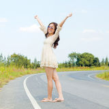 Woman stan on the road in a happy feel. Royalty Free Stock Photography