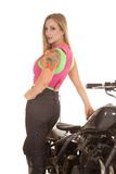 Woman stand back to motorcycle tattoo Royalty Free Stock Photography