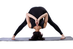 Woman stand on cover - doing yoga pose Royalty Free Stock Photography
