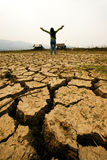 Woman stand on drought Stock Photos