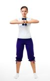 Woman stand with dumbbells Royalty Free Stock Image