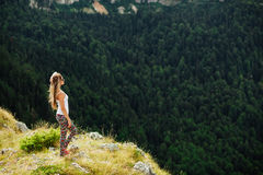 Woman stand at the end of earth in fascinating landscape Royalty Free Stock Photography