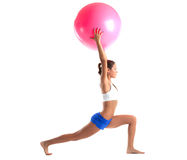 Woman stand with fitness ball isolated Royalty Free Stock Images