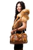 Woman stand with fur and bag Stock Images