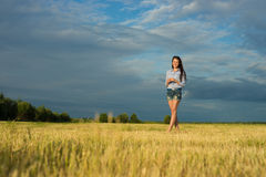 Woman stand in grass field Royalty Free Stock Image