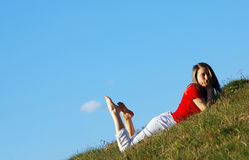 Woman stand in grass field Stock Photos