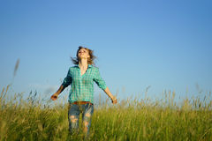 Woman stand in grass field Stock Images