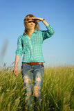 Woman stand in grass field Royalty Free Stock Images
