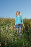 Woman stand in grass field Stock Image