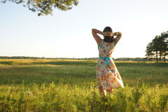 Woman stand in grass field Royalty Free Stock Photos