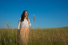 Woman stand in grass field Stock Photography