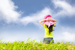 Woman stand in the grass field Stock Images