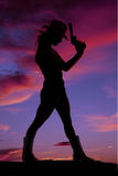Woman stand gun silhouette Stock Photography