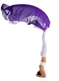 Woman stand on head with purple fabric yoga chakra Royalty Free Stock Photography
