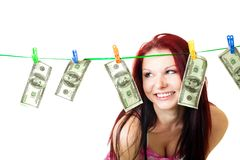 Woman stand and look at rope with us dollars Royalty Free Stock Photos