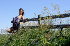 Woman stand near wooden fence Royalty Free Stock Photos