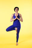 Woman stand on one leg in yoga pose Royalty Free Stock Photo