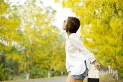 Woman stand on the road full yellow flower Stock Images