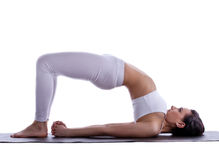 Woman stand on spine - doing yoga asana isolated Royalty Free Stock Photography