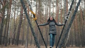 Woman Stand In Swing Sway Park Nature Scenery. Happy Caucasian Girl Relax Outdoor Recreation Autumn Trees Background. Pretty Young Girl Have Fun Outside Good stock video footage