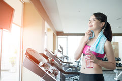 Woman stand on treadmill Royalty Free Stock Photography
