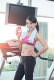 Woman stand on treadmill Stock Photos