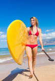 Woman with Stand Up Paddle Board. Attractive Woman with Stand Up Paddle Board, SUP, on the beach in Hawaii Stock Image