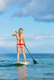 Woman on Stand Up Paddle Board. Attractive Woman on Stand Up Paddle Board, SUP, Tropical Blue Ocean, Hawaii Royalty Free Stock Image