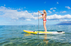 Woman on Stand Up Paddle Board. Attractive Woman on Stand Up Paddle Board, SUP, Tropical Blue Ocean, Hawaii Royalty Free Stock Photos