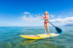 Woman on Stand Up Paddle Board. Attractive Woman on Stand Up Paddle Board, SUP, Tropical Blue Ocean, Hawaii Royalty Free Stock Photography