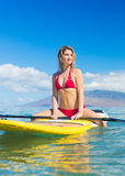 Woman on Stand Up Paddle Board. Attractive Woman on Stand Up Paddle Board, SUP, Tropical Blue Ocean, Hawaii Stock Photos