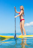 Woman on Stand Up Paddle Board. Attractive Woman on Stand Up Paddle Board, SUP, Tropical Blue Ocean, Hawaii stock image