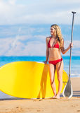 Woman with Stand Up Paddle Board. Young Attractive Woman on Stand Up Paddle Board, SUP, in the Blue Waters off Hawaii Stock Image