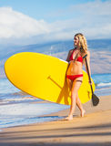 Woman with Stand Up Paddle Board. Young Attractive Woman on Stand Up Paddle Board, SUP, in the Blue Waters off Hawaii Royalty Free Stock Photos
