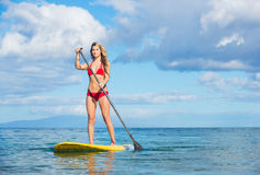 Woman on Stand Up Paddle Board. Young Attractive Woman on Stand Up Paddle Board, SUP, in the Blue Waters off Hawaii, Active Life Concept Royalty Free Stock Photography