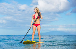 Woman on Stand Up Paddle Board. Young Attractive Woman on Stand Up Paddle Board, SUP, in the Blue Waters off Hawaii, Active Life Concept Stock Image