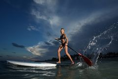Woman stand up paddle boarding Royalty Free Stock Image