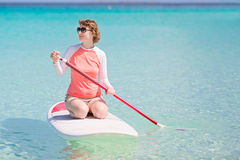 Woman stand up paddleboarding Royalty Free Stock Images