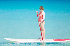 Woman stand up paddleboarding Royalty Free Stock Photography