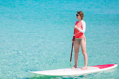 Woman stand up paddling Stock Image