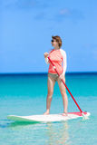 Woman stand up paddling Royalty Free Stock Photo