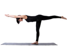 Woman stand in yoga asana - half moon pose Stock Photo