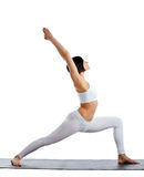 Woman stand in yoga pose on rubber mat Stock Photos