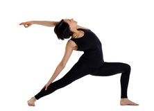 Woman stand in yoga pose - warrior asana Royalty Free Stock Photography