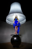 Woman - standard lamp Royalty Free Stock Image