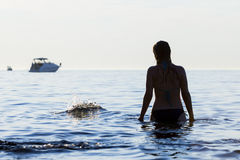 Woman standing in Adriatic sea Stock Image