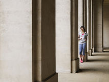 Woman Standing Against Column In Portico Stock Photography