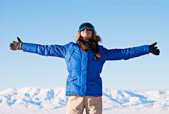 Woman standing against snowy mountains Royalty Free Stock Image